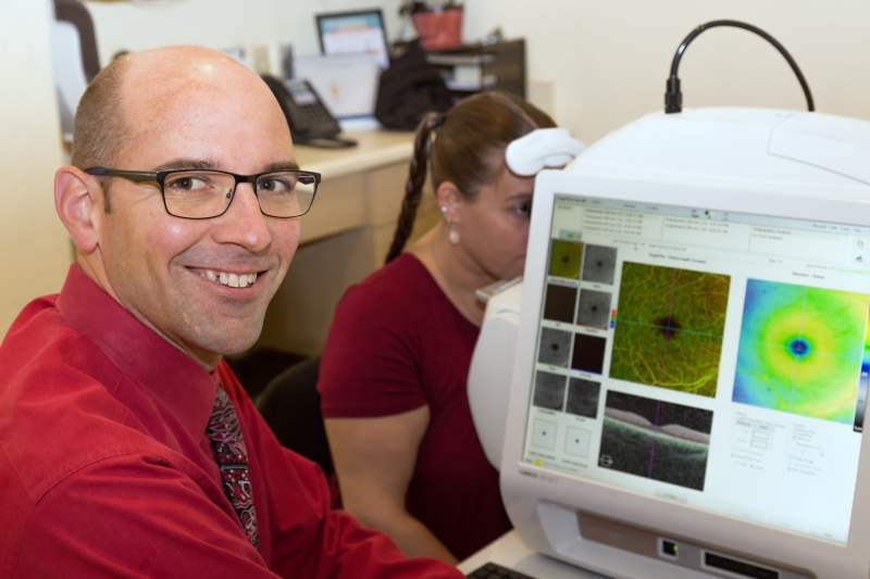 Dr. Cole conducts a comprehensive eye exam